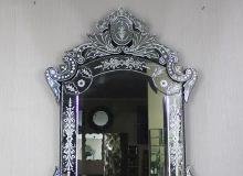 venetian and wooden frame mirror